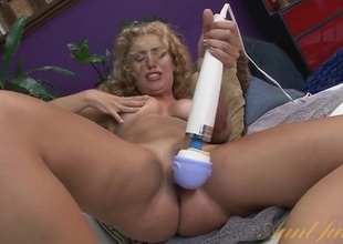 Long curly barb babe gets soaking wringing wet with a toy