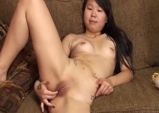 Masturbating amateur Asian with sexy tattoos