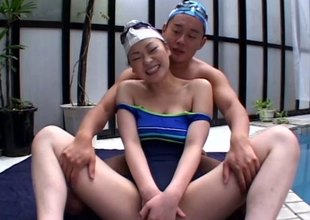 Asian cutie relative to a swimsuit fucked as she moans erotically