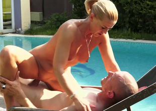 Bodily blonde chick Margery gets drilled unstintingly in the poolside