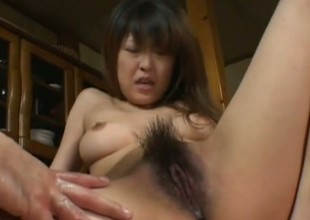 Obscene Japanese floozie is finger fucked in kinky porn clip