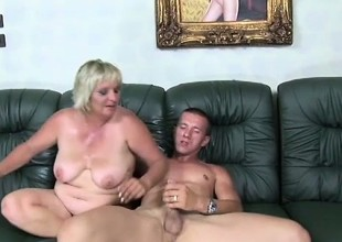 Lustful adult mart with big tits pate sucks with an increment of fucks a young stud's long Hawkshaw