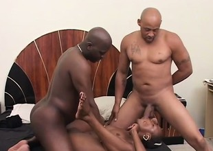 A cock hungry black bitch enjoys feeding time here a pair of guys