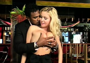 Captivating blonde with stunning breasts makes love with a black stud