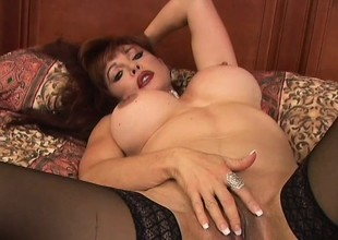 Shove around redhead MILF Vanessa wears fishnets in this hardcore scene