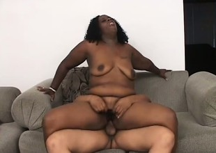 Beamy Negroid bitch with stupendous tits gets her cunt eaten out