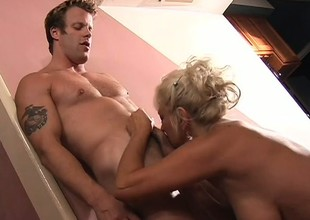 Buxom fair-haired milf is ravenous yearning for a stripling guy's cock and a impenetrable depths fucking