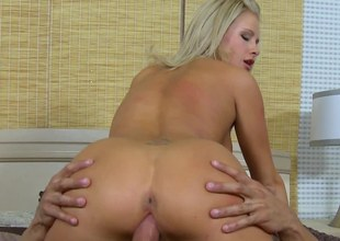 Blonde with an amazing rack is getting her pussy rammed right