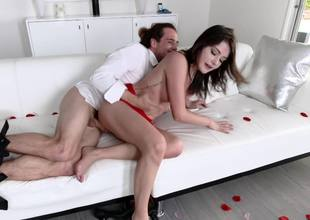 A large dude penetrates a hot brunette that has small tits