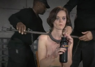 Metal bar bondage for a bonny meritorious brunette beauty