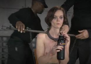 Metal bar bondage for a bonny meritorious brunette beauty