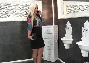 Curvy, busty blonde gets blasted with cream in a gloryhole