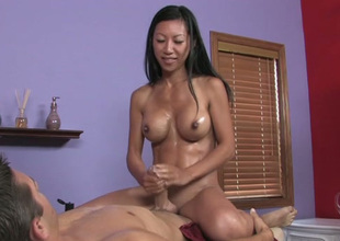 Busty Asian massage therapist is getting naughty with her buyer