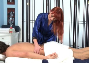 Redhead coed makes a living out be required of sucking cocks and immense massages