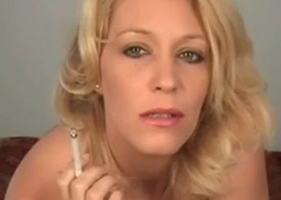 Blonde mom smokes and stuffs her shaved pussy with the cigarette