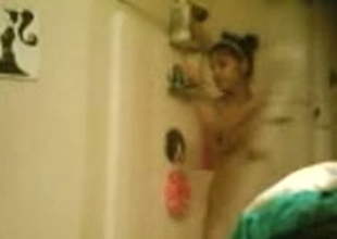 Hidden camera films amateur Indian girl in shower