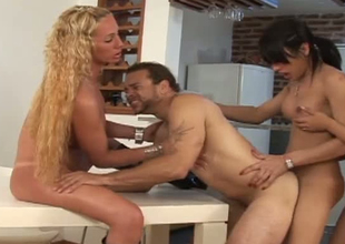Brunette and blonde shemale babes gangbang a white guy