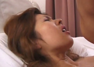 Skinny Japanese whore with fake chest is screwed bad in a missionary intersection