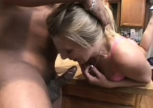 A cheating blonde housewife goes wild with a throbbing black spiral