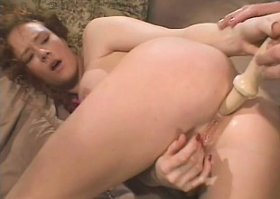 Filthy redhead with big tits has a smart dick roughly drilling her ass