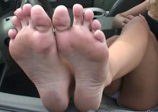 Downcast dusty feet out the car