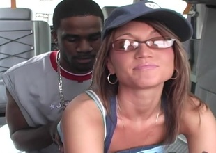Sassy cowgirl is banged approximately the lead backseat of a motor car approximately this well done interracial video