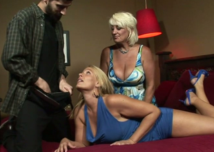 Dana Hayes and Melanie Monroe give double blowjob to a hot guy