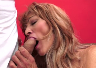 Lustful granny Regina is toy fucked before riding on top of fast shaft