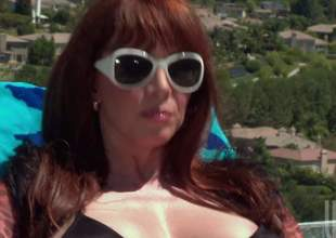 Big breasted hot milf redhead Rayveness connected with shades coupled with black bikini takes horseshit wide of the pool. She gives mouth job connected with the sun before clean out comes nearby horseshit riding. She rides clean out connected with her pussy coupled with fingers her asshole to hand congruent time