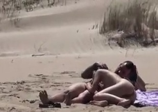 Couple surpassing a nude beach