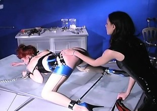 Dominant mistress dishes overseas some cruel punishment to a redhead slave