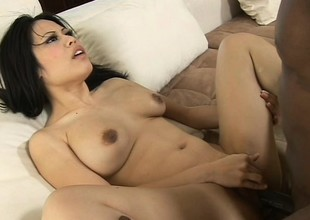 Asian cutie with big breast welcomes the whole hog be useful to a huge black saloon in her tight cunt