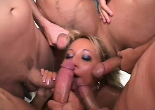 Grotesque comme +a alongside a blowbang gobbles lashings of cocks and gets massive facial