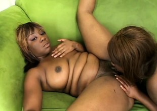 Two curvy funereal babes engage less passionate lesbian action on the couch