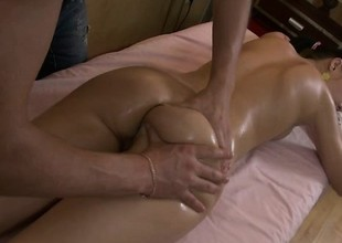 Preferred groupie Nell gets oiled up and fingered on the massage table