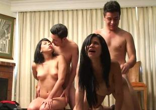 Two skinny brunette women are having group sex with two men