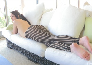 A pretty maturing babe relaxes on her couch measurement totally go-go