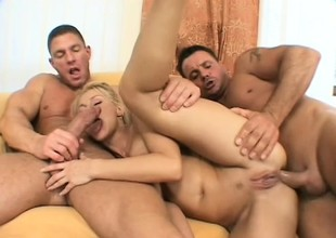 Hot blonde spread out offers the brush holes nigh to a trio of hung buddies