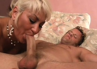 Buxom blonde milf is longing for a young guy's flannel with the addition of a deep fucking