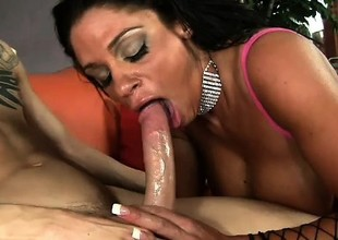 MILF with stunning dark skin and hefty hoax bosom rides Chris Strokes