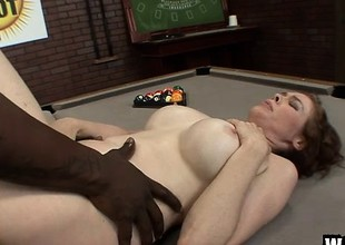Buxom redhead mommy Mae Victoria takes a black prick in her gradual peach
