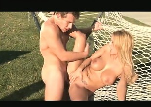Feisty blonde yellow-belly nut Trina Michaels grinds on a mean meat-rod