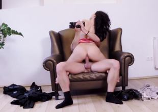 Leather chair is the unquestionable place to bang a sexy dark-haired cutie
