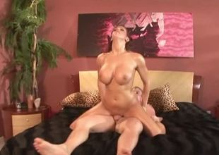 A hot babe with massive tits is getting her hairy pussy pounded