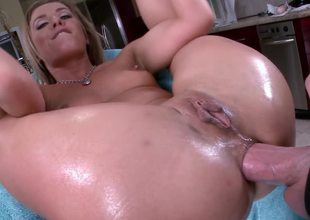 Blonde is having a cock placed inside her ass and it goes in deep