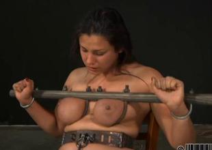 Gagged girl relating to clamped teats gets shunned amusement