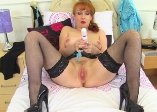 Lingerie milf lubes their way twat and loops above their way pussy