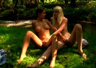 Naked teenage nymphs kissing in the forest