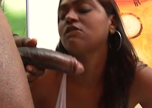 Lewd chunky bottomed chocolate masseuse gives conscientious handjob increased by blowjob to BBC