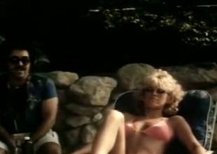 Selected blonde in nice boobies is having sex by rub-down the pool